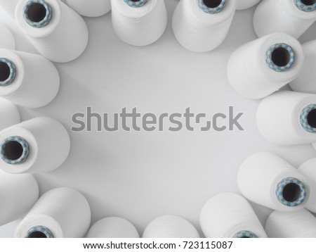 top view of A lot of yarn spools with copy space, textile factory, Textile industry concept, Cotton manufacturing.