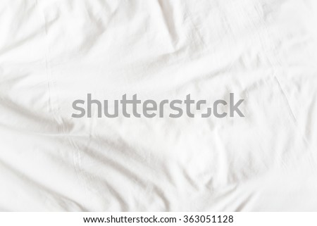 Top view of a messy bedding sheet after night sleep.