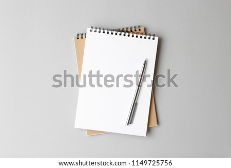 top view of a open notebook with pen on a gray background, school notebooks with a spiral spring, office notepad flat lay #1149725756