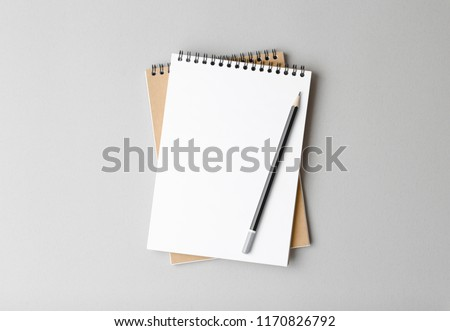 top view of a open notebook with pencil on a gray background, school notebooks with a spiral spring, office notepad flat lay #1170826792
