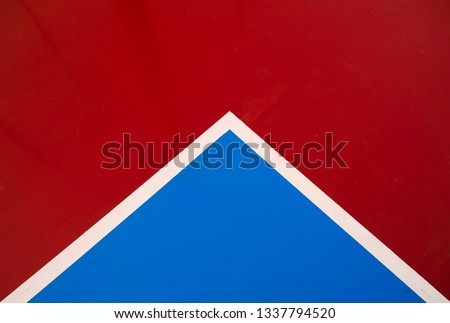 Top view of a playing field, a section showing red and blue corner section, resemblance of an envelope. #1337794520