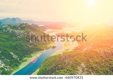 Top view of a river  in the mountains on a sunny day on a sunny day #660970831