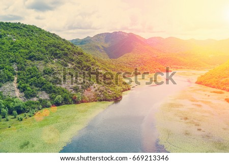 Top view of a river  in the mountains on a sunny day on a sunny day #669213346