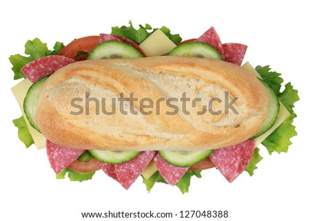 Top view of a sandwich with pepperoni, cheese, tomatoes, lettuce and cucumber
