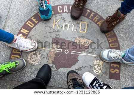 Top view of a symbol called Zero kilometre from Spain, with nine feet around. Place marked on the floor that is a sketch of the design of Spain, something symbolic.Popular meeting place Puerta del Sol Foto stock ©