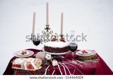 Top view of a table with cake and decore, candels. #554464009