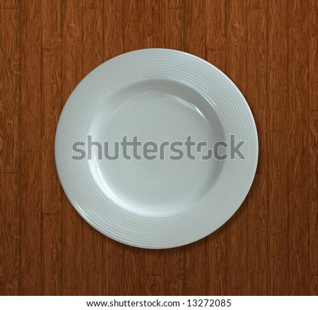 Top view of a white dish on a textured background