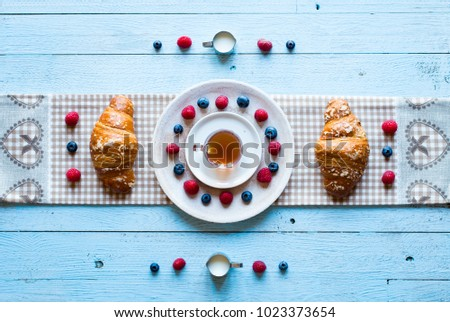 Top view of a wood table full of cakes, fruits, coffee, biscuits, spices and more breakfast classic sweet foods. #1023373654