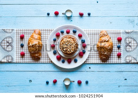 Top view of a wood table full of cakes, fruits, coffee, biscuits, spices and more breakfast classic sweet foods. #1024251904