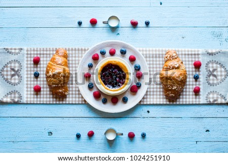 Top view of a wood table full of cakes, fruits, coffee, biscuits, spices and more breakfast classic sweet foods. #1024251910