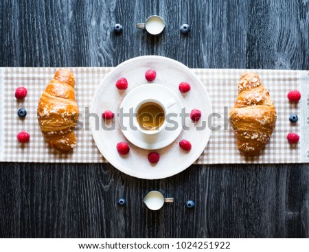 Top view of a wood table full of cakes, fruits, coffee, biscuits, spices and more breakfast classic sweet foods. #1024251922
