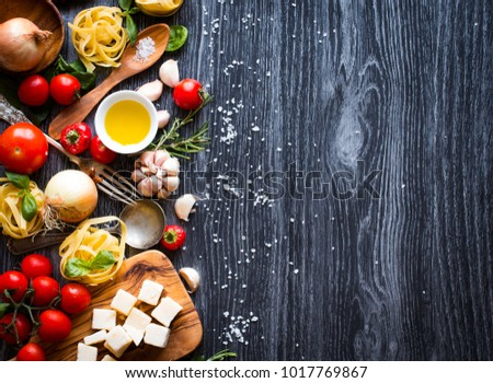 Top view of all the necessary food component to make a classic italian pasta with tomato sauce with basil and olive oil! #1017769867