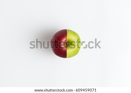 Shutterstock Top view of an apple combined from two half of red and green color isolated