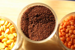 Top view of an assortment of dried black tea and pulses