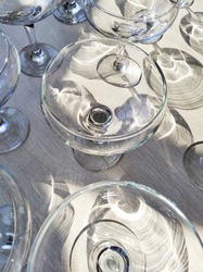 Top view of an empty glass of wine and a martini on a white wooden table.shadow on the table from the glass glasses