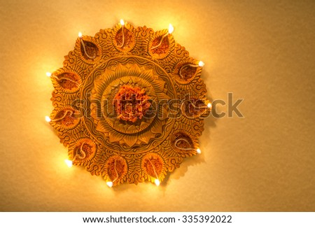 Free photos a traditional indian lamp diwali greeting card cover top view of an illuminated terra cotta diwali lamp view from above m4hsunfo