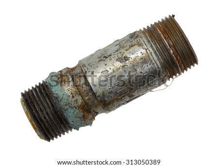 Top view of an old and leaking short pipe nipple with remains of pipe thread compound on a white background.