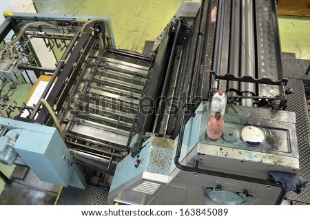 Old printing press machine work Images and Stock Photos