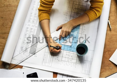 Top view of architect drawing on architectural project - Shutterstock ID 347420135
