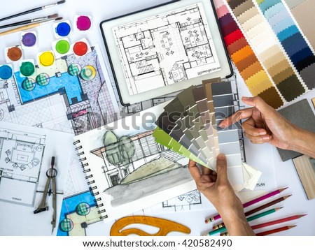 Detail  Top view of architect & interior designer working at worktable  with color swatch, tablet,