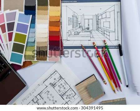 Top view of architects  desk with laptop computer, shop drawing, material sample on desk - Shutterstock ID 304391495