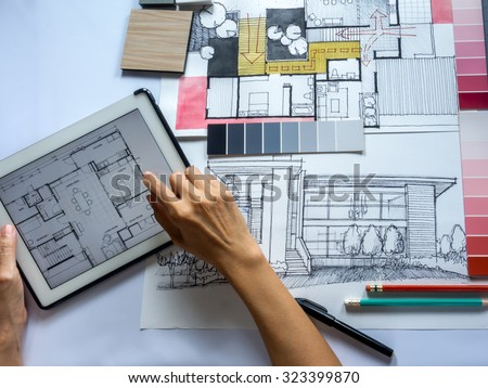 Top View Of Architects U0026 Interior Designers Hands Working On Table With  Tablet And Illustration/