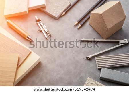 Top view of architects table with stuff of modern house with material sample on creative desk with free copyspace #519542494