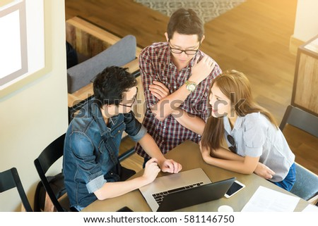 Top view of Asian Team group freelancer are brainstorming and meeting at coffee shop cafe.  #581146750