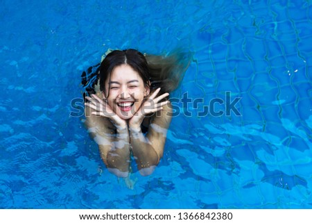 68e2b0b70745e Free · Premium; Filters. 3/67. Top view of Asian woman smiling happily  standing in the blue swimming pool. #1366842380