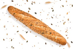 Top view of baguette topped with different seeds, such as pumpkin, flax, sunflower, sesame, millet and  poppyseeds decorated with wheat ears isolated on white background.