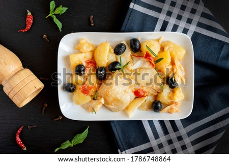 top view of Baked Codfish baccala Recipe with Potatoes and Olives Stock photo ©