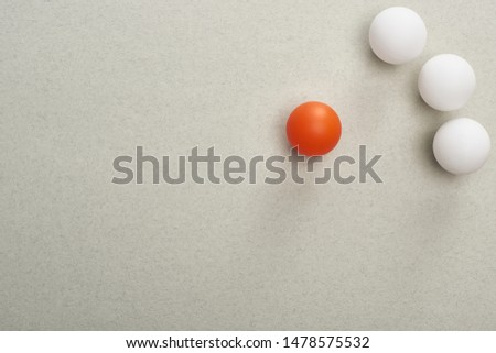 top view of balls symbolizing victim and abusers on grey background #1478575532