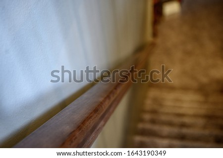 Top view of banister stair railing with close focus and blurred stairway stock photo