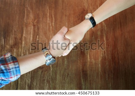Top view of banker and customer handshake, businessman and businesswoman trust  hold hand together, good relationship business partner deal
