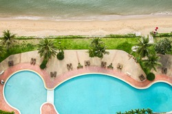 Top View of Beach and sea with pool tropical background