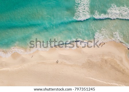 Top view of beautiful beach and Caribbean Sea. Aerial drone shot of turquoise sea water at the beach - space for text. Cancun beach aerial view.