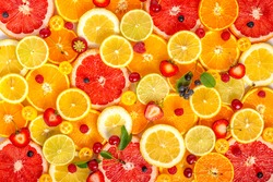top view of  beautiful fresh trendy seamless pattern sliced mixed citrus fruits as background with different berries, concept of healthy eating, dieting