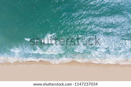 Top view of beautiful sand beach with turquoise sea water,Wave propagation,aerial view from drone camera / Summer concept. #1147237034