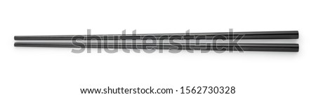 Top view of black chopsticks isolated on white background Stock photo ©
