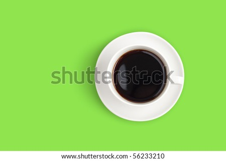 Top view of black coffee cup on green background