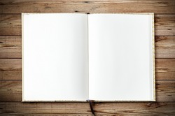 Top view of blank open notebook page on wood background office desk with little tree. Minimal flat lay style