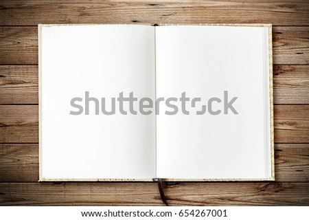 Top view of blank open notebook page on wood background office desk with little tree. Minimal flat lay style #654267001