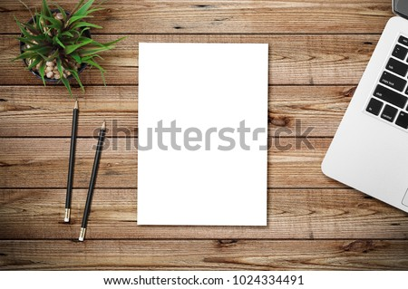 Top view of blank paper page on wood background office desk and different objects. Minimal flat lay style #1024334491