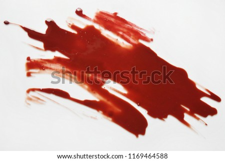Top view of blood red Spread on white ground.