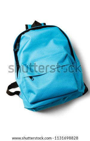 Top view of blue school backpack on white background