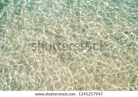 Top view of blue sea and sand texture. Aerial beach ocean water background. Bright and light instagram photo filter.
