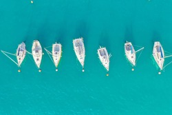 Top view of boats and yachts in the marina from above. Marina, Marina, Yacht and sailboat are moored to the pier. Aerial view by drone. Italy, sunny coast