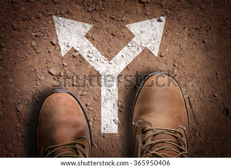 Top View of Boot on the trail with directional arrow