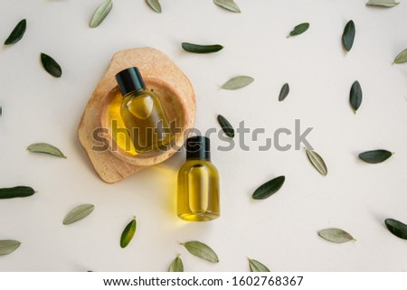 Top view of bottles essential olive oil. Healthy natural cosmetic treatment, massage treatment product