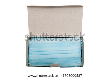 Top view of box with 50 pcs of surgical disposable face mask (3-Ply) with earloop isolated on white background - used in COVID-19 global pandemic of coronavirus SARS-CoV-2